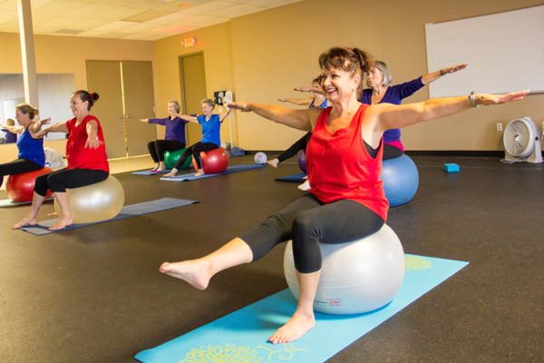 A COM 50 Plus Program yoga class