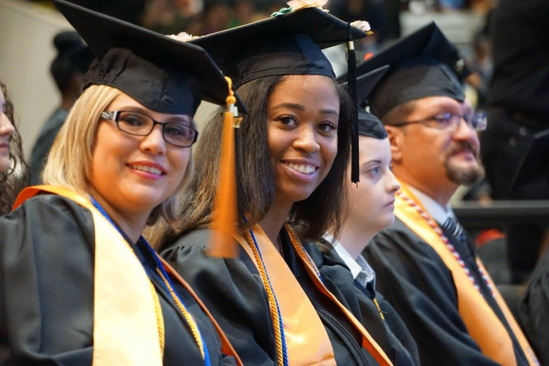Rose Pipkin, left, and other COM 2017 graduates