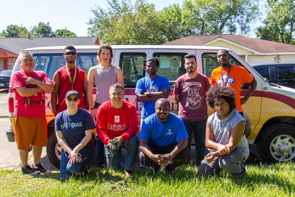 College of the Mainland staff and students help a nearby homeowner clean his home.