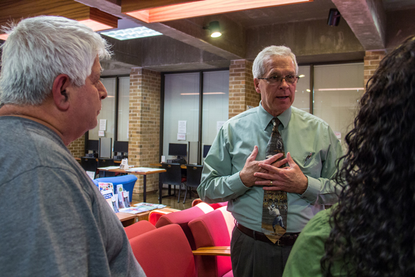 College of the Mainland President Warren Nichols talks with students.