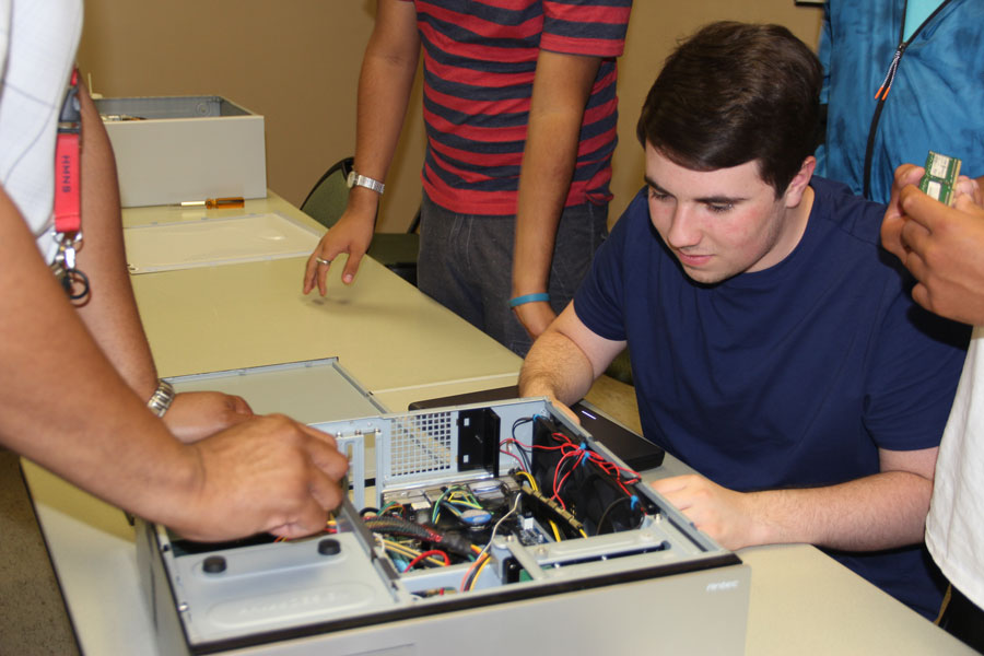Networking students taking apart a computer