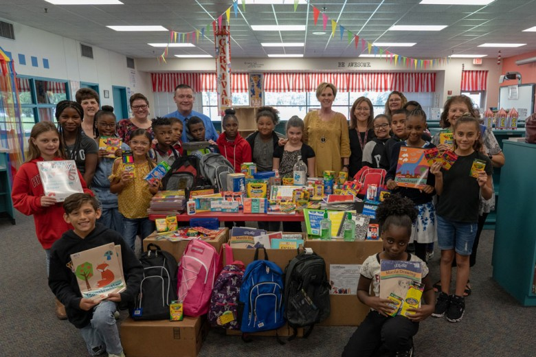 Group of school kids receiving an assortment of school supplies