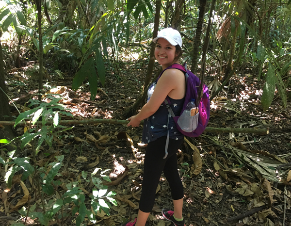 College of the Mainland student Bethel Moreno hikes through the jungle in Belize on a college study abroad trip.