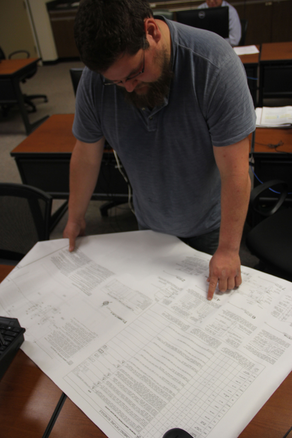 Student Kevin Ingram looks at building plans.