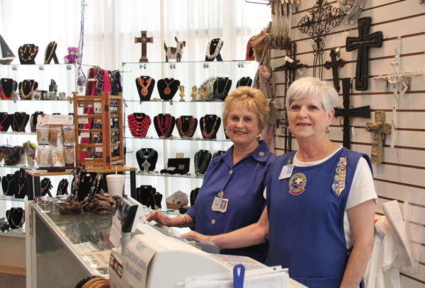 Adele Parrish, left, and Marilyn Decker, right, work in the Mainland Medical Center Auxiliary Gift Shop, which donates profits to COM Foundation for student scholarships.