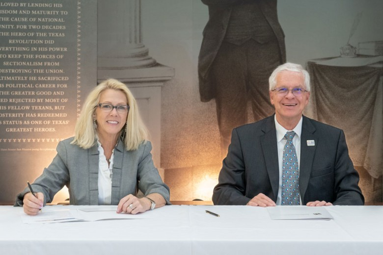 Sam Houston State University President, Dr. Dana G. Hoyt and College of the Mainland President, Dr. Warren Nichols signing agreement