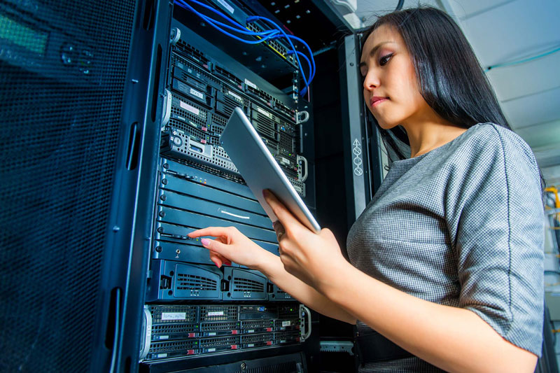 Asian woman working on computer servers