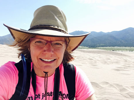 Photo of Dr. Diane Neudorf on a sand dune.